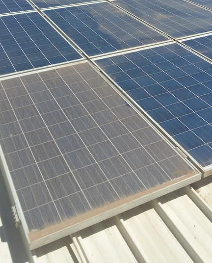 Dirty solar panel compared to clean one